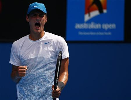 Bernard Tomic of Australia celebrates during his men's singles match against Daniel Brands of Germany at the Australian Open tennis tournament in Melbourne, January 17, 2013. REUTERS/David Gray