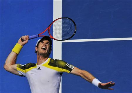 Andy Murray of Britain serves to Joao Sousa of Portugal during their men's singles match at the Australian Open tennis tournament in Melbourne January 17, 2013. REUTERS/Toby Melville