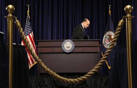 U.S. Chairman of the Federal Reserve Ben Bernanke departs after holding a news conference in Washington December 12, 2012. REUTERS/Kevin Lamarque (UNITED STATES - Tags: POLITICS BUSINESS)
