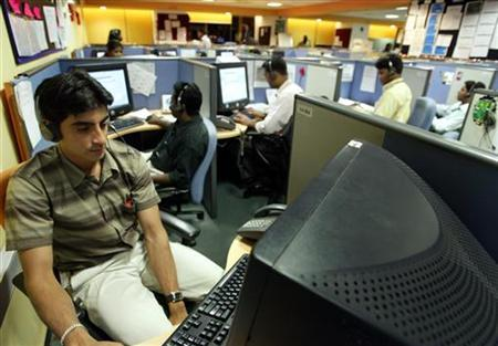 Indian employees at a call centre provide service support to international customers in the southern city of Bangalore March 17, 2004. REUTERS/Sherwin Crasto/Files
