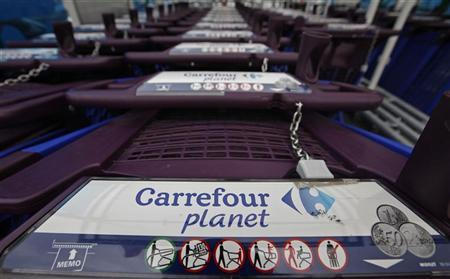 Shopping trolleys with the logo of Carrefour Planet supermarket line up at the entrance of the supermarket in Nice August 23, 2012. REUTERS/Eric Gaillard