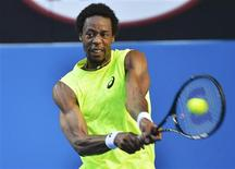 Gael Monfils of France hits a return to Lu Yen-Hsun of Taiwan during their men's singles match at the Australian Open tennis tournament in Melbourne January 17, 2013. REUTERS/Toby Melville