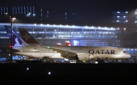 Qatar Airways' new Boeing 787 Dreamliner aircraft is parked after its first arrival at Zurich Airport in Zurich, January 14, 2013. REUTERS/Michael Buholzer