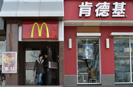 People walk out from a McDonald's restaurant next to a KFC restaurant in Taiyuan, Shanxi province, January 17, 2013. REUTERS/Stringer