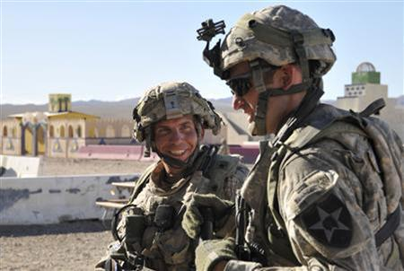 Staff Sgt. Robert Bales (L) is seen during a training exercise at Fort Irwin, California, in this August 23, 2011 DVIDS handout photo. REUTERS/Department of Defense/Spc. Ryan Hallock/Handout/Files