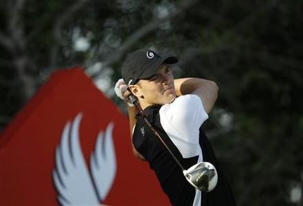 Martin Kaymer of Germany tees off on the 13th hole during the first round of the Abu Dhabi Golf Championship at the Abu Dhabi Golf Club January 17, 2013. REUTERS/Ahmed Jadallah
