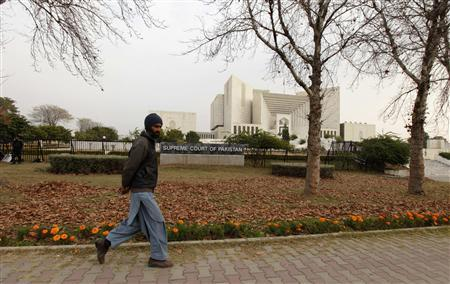 A man walks past the Supreme Court building in Islamabad Januray 17, 2013. Pakistan's coalition government opened talks on Thursday with a Muslim cleric whose calls for the administration to resign have electrified thousands of protestors camped out near parliament. REUTERS/Faisal Mahmood