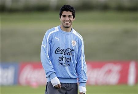 Luis Suarez smiles during a team practice in Montevideo June 4, 2012. REUTERS/Andres Stapff/Files