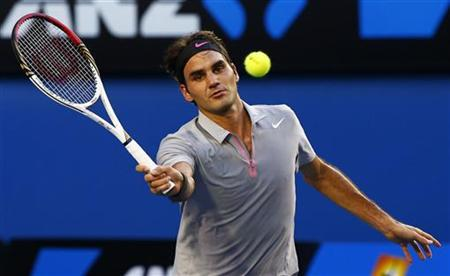 Roger Federer of Switzerland hits a return to Nikolay Davydenko of Russia during their men's singles match at the Australian Open tennis tournament in Melbourne January 17, 2013. REUTERS/David Gray