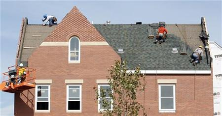 Builders work at the roof of a new housing construction site in Alexandria, Virginia October 17, 2012. REUTERS/Kevin Lamarque