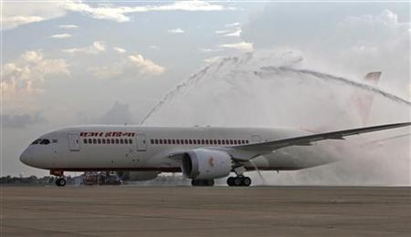 The Air India's Boeing 787-800 Dreamliner is been given a traditional water cannon salute by the fire tenders upon its arrival at the airport in New Delhi September 8, 2012. REUTERS/Mansi Thapliyal/Files