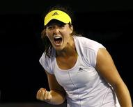 Laura Robson of Britain celebrates defeating Petra Kvitova of Czech Republic in her women's singles match at the Australian Open tennis tournament in Melbourne, January 18, 2013. REUTERS/David Gray