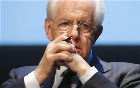 Outgoing Prime Minister Mario Monti attends at the presentation of ''La Democrazia in Europa'' the book he wrote with Euro-MP Sylvie Goulard in Rome, January 9, 2013. REUTERS/Stefano Rellandini
