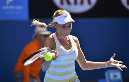 Donna Vekic of Croatia hits a return to Caroline Wozniacki of Denmark during their women's singles match at the Australian Open tennis tournament in Melbourne January 17, 2013. REUTERS/Toby Melville