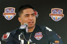 Notre Dame Fighting Irish linebacker Manti Te'o speaks during media day for the 2013 BCS National Championship NCAA football game in Miami, Florida in this January 5, 2013, file photo. REUTERS/Jeff Haynes/Files