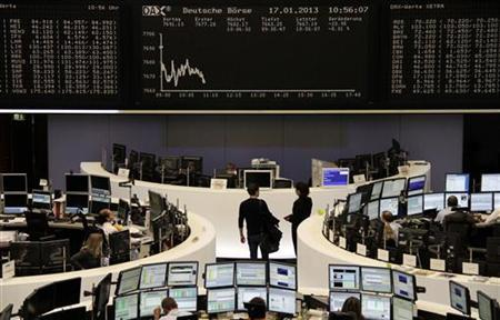 The DAX board is pictured at the Frankfurt stock exchange January 17, 2013. REUTERS/Remote/Marte Kiessling (GERMANY - Tags: BUSINESS)