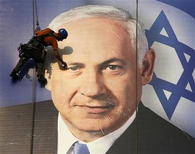 A worker installs a banner depicting Israel's Prime Minister Benjamin Netanyahu in Tel Aviv January 17, 2013. Netanyahu looks set to form a new governing coalition after next week's election, polls show, with the only question being whether he wants to soften its hardline contours. REUTERS/Baz Ratner