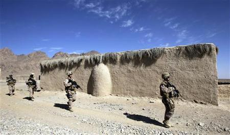 U.S. Marines of Police Advisory Team Now Zad, 2nd Battalion, 7th Marines Regiment patrol a village near a police station in Now Zad district in Helmand province, southwestern Afghanistan November 8, 2012. REUTERS/Erik De Castro