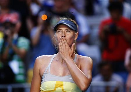 Maria Sharapova of Russia blows kisses to the crowd after defeating Misaki Doi of Japan during their women's singles match at the Australian Open tennis tournament in Melbourne January 16, 2013. REUTERS/David Gray
