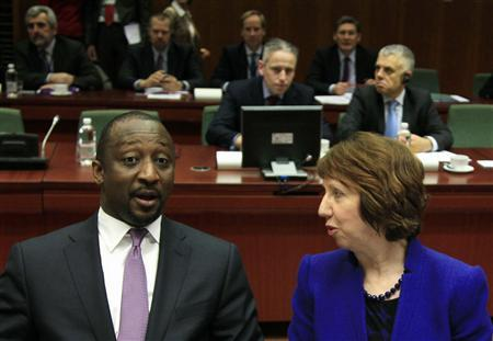 Mali's Foreign Minister Tieman Hubert Coulibaly (L) talks to EU foreign policy chief Catherine Ashton during an European Union emergency foreign ministers meeting in Brussels, to discuss the crisis in Mali January 17, 2013. REUTERS/Yves Herman
