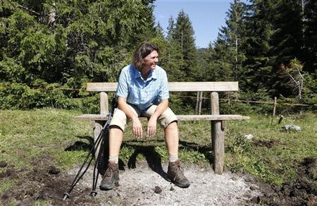 German Agriculture Minister Ilse Aigner takes a break during the annual alpine pasture inspection near the Koenigsalm, southern Germany, in Kreuth August 1, 2012. REUTERS/Michaela Rehle