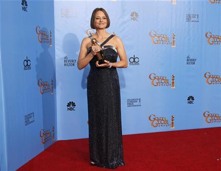 Actress Jodie Foster poses with her Cecil B. DeMille award at the 70th annual Golden Globe Awards in Beverly Hills, California January 13, 2013. REUTERS/Lucy Nicholson