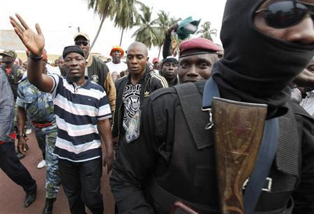 Charles Ble Goude (L), leader of the ''Young Patriots'' movement, and supporters of incumbent Ivory Coast leader Laurent Gbagbo attend a rally at Champroux stadium in Abidjan January 23, 2011. REUTERS/Thierry Gouegnon