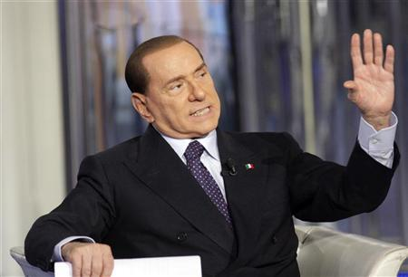 Italy's former Prime Minister Silvio Berlusconi gestures as he appears as a guest on the RAI television show Porta a Porta (Door to Door) in Rome January 9, 2013. REUTERS/Remo Casilli