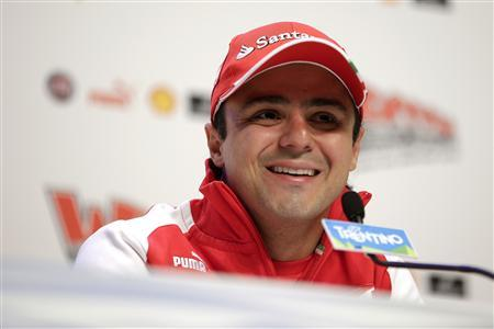 Ferrari Formula One driver Felipe Massa of Brazil looks on during a news conference at the Wrooom, F1 and MotoGP Press Ski Meeting, Ducati and Ferrari's annual media gathering, in Madonna di Campiglio January 17, 2013. REUTERS/Max Rossi