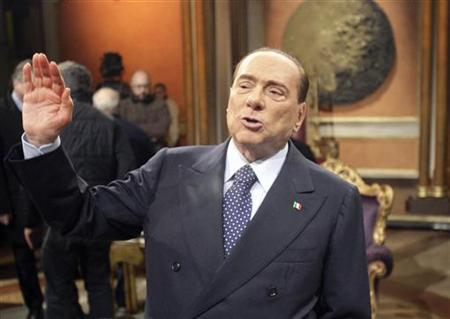 Former Italian Prime Minister Silvio Berlusconi gestures before the taping of the talk show ''Telecamere'' at Rai television in Rome January 11, 2013. REUTERS/Remo Casilli
