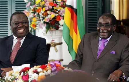 Zimbabwean President Robert Mugabe (R) and Prime Minister Morgan Tsvangirai address a media conference at State House in the capital Harare January 17, 2013. REUTERS/Philimon Bulawayo