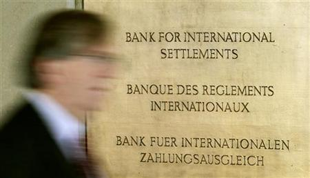 A man walks past a sign in front of the Bank For International Settlements (BIS) in Basel November 8, 2010. REUTERS/Arnd Wiegmann