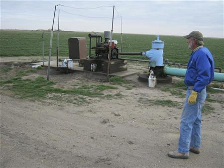 Farmer Gail Wright is pictured next to a water pump which he says he is likely to shut down because the Ogallala Aquifer no longer provides adequate water near Sublette, Kansas, November 26, 2012. REUTERS/Kevin Murphy