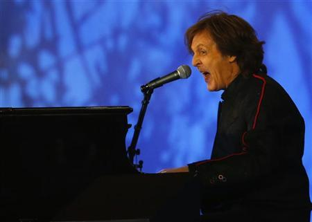 Musician Paul McCartney performs during the opening ceremony of the London 2012 Olympic Games at the Olympic Stadium July 27, 2012. REUTERS/Mike Blake
