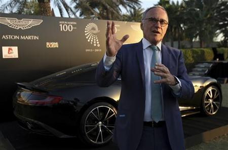 Ulrich Bez, CEO of Aston Martin, speaks to Reuters during the company's centenary celebrations in Dubai January 17, 2013. REUTERS/Nikhil Monteiro