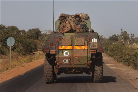 French military pass the town of Konobougou on their way to Segou, Mali January 17, 2013. REUTERS/Joe Penney
