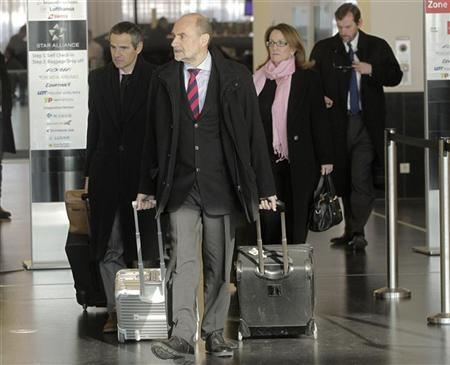 Herman Nackaerts (C) and members of a delegation of the International Atomic Energy Agency (IAEA) check-in before their departure to Iran, at the airport in Vienna January 15, 2013. REUTERS/Herwig Prammer