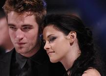 Actors Robert Pattinson (L) and Kristen Stewart arrive for the British premiere of 'The Twilight Saga: Breaking Dawn' at Westfield Stratford City cinemas in east London November 16, 2011. REUTERS/Toby Melville