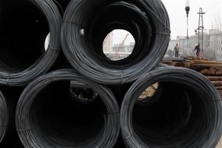 Labourers work at a steel market in Shanghai January 9, 2013. REUTER/Aly Song
