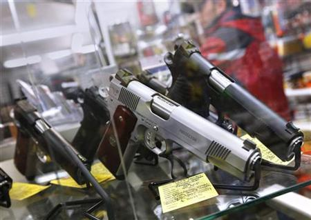 A display of 7-round .45 caliber handguns are seen at Coliseum Gun Traders Ltd. in Uniondale, New York January 16, 2013. REUTERS/Shannon Stapleton