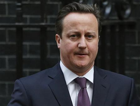 Britain's Prime Minister David Cameron leaves Number 10 Downing Street to attend Prime Minister's Questions at parliament in London January 16, 2013. REUTERS/Olivia Harris