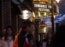 People walk past the Egyptian Theatre along Main Street before the opening day of the Sundance Film Festival in Park City, Utah, January 16, 2013. REUTERS/Jim Urquhart