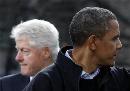 U.S. President Barack Obama and former President Bill Clinton appear onstage together after Obama addressed the crowd at a campaign event at State Capitol Square in Concord, New Hampshire, November 4, 2012. REUTERS/Larry Downing/Files