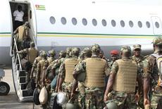 Togolese Army soldiers enter a plane to leave for deployment to Mali, from Togo's capital Lome January 17, 2013. REUTERS/Noel Kokou Tadegnon (TOGO - Tags: MILITARY CIVIL UNREST CONFLICT)