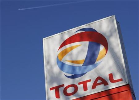 A logo for oil giant Total is seen at a petrol station in London February 12, 2008. REUTERS/Stephen Hird