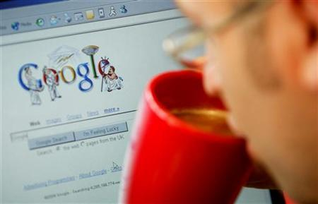 An internet surfer views the Google home page at a cafe in London, August 13, 2004. REUTERS/Stephen Hird