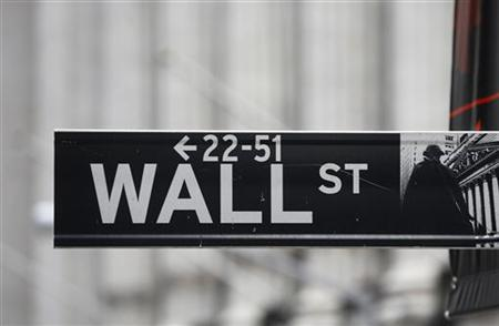 A Wall Street sign is seen in front of the exterior of the New York Stock Exchange November 7, 2012. REUTERS/Chip East/Files
