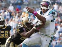 Carolina Panthers' quarterback Cam Newton (R) is hit by New Orleans Saints' middle linebacker Jonathan Vilma during an NFL football game in Charlotte, North Carolina in this file photo taken October 9, 2011. A federal judge on Thursday dismissed Vilma's defamation lawsuit against National Football League Commissioner Roger Goodell, one of the last open issues in the team's so-called bounty scandal. REUTERS/Chris Keane/Files