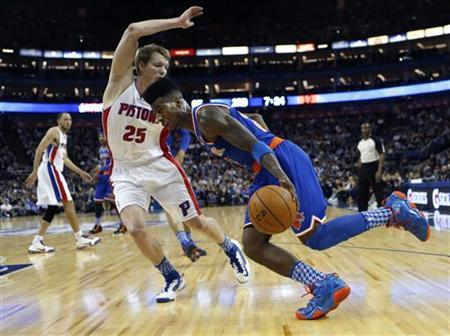 New York Knicks point guard Iman Shumpert (R) takes Detroit Pistons small forward Kyle Singler (25) along the baseline to the basket during their regulation NBA basketball game played at the O2 Arena in London, England January 17, 2013. REUTERS/Suzanne Plunkett