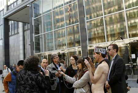 Nudists gathered prior to a hearing on a lawsuit seeking to block implementation of San Francisco's ban on public nudity. REUTERS/Robert Galbraith